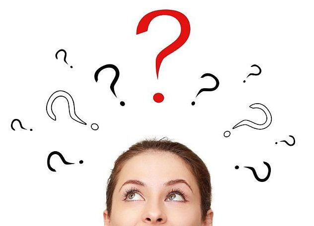 Thinking woman looking up on many question signs above head isolated on white background